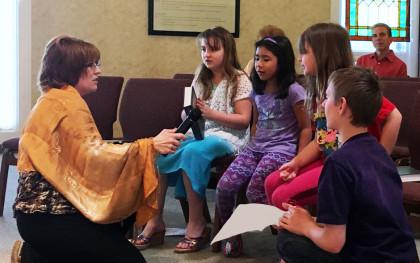 Susan Galle Boyko w RE children at service_edited-1